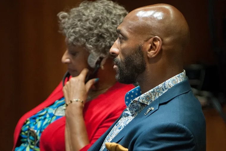 Former Eagle Irving Fryar sits next to his mother, Allene McGhee, during testimony in his case at the Burlington County Courthouse in Mount Holly on Wednesday, July 29, 2015. (TRACIE VAN AUKEN/ For The Inquirer)