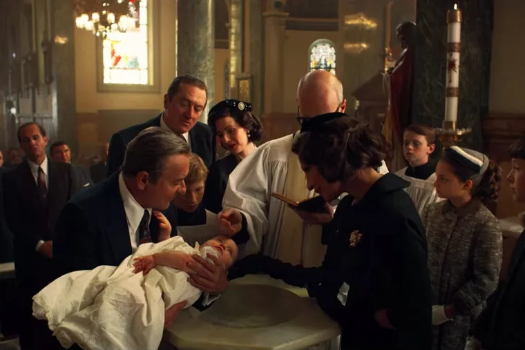"""Robert De Niro as Frank Sheeran watches Joe Pesci as Pennsylvania mob boss Russell Bufalino participate in the christening of Sheeran's daughter at what appears to be """"The Irishman's"""" version of Our Mother of Sorrows church in West Philly."""