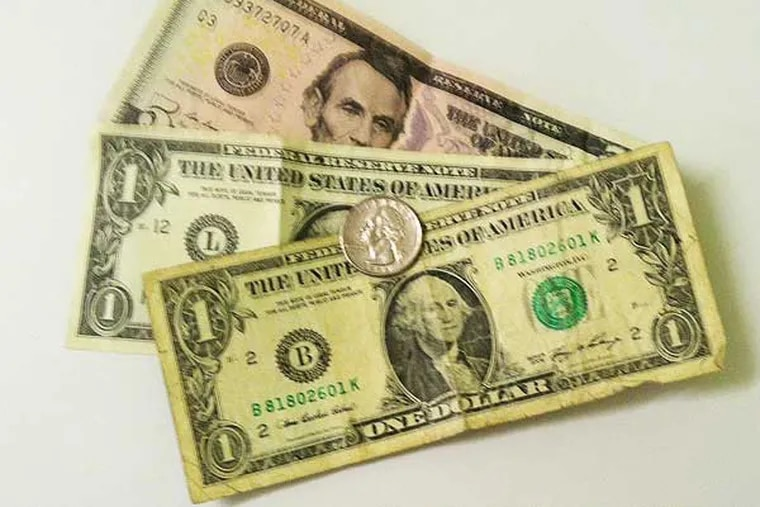 $7.25 is the current federally-mandated minimum wage in the U.S. (Dave Ralis / Philly.com)