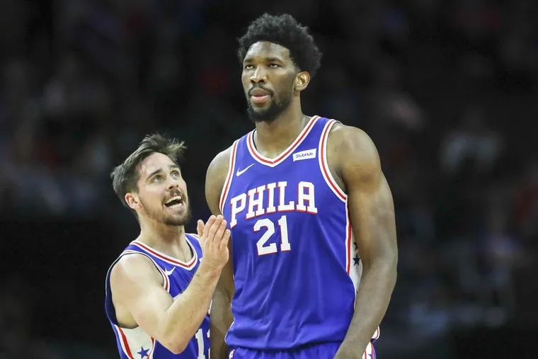 Sixers center Joel Embiid with teammate guard T.J. McConnell against the Utah Jazz on Monday, Nov. 20, 2017 in Philadelphia.