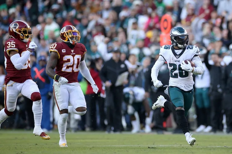 Eagles running back Miles Sanders burns downfield on a 56-yard run that set up a fourth-quarter touchdown at Washington on Sunday.