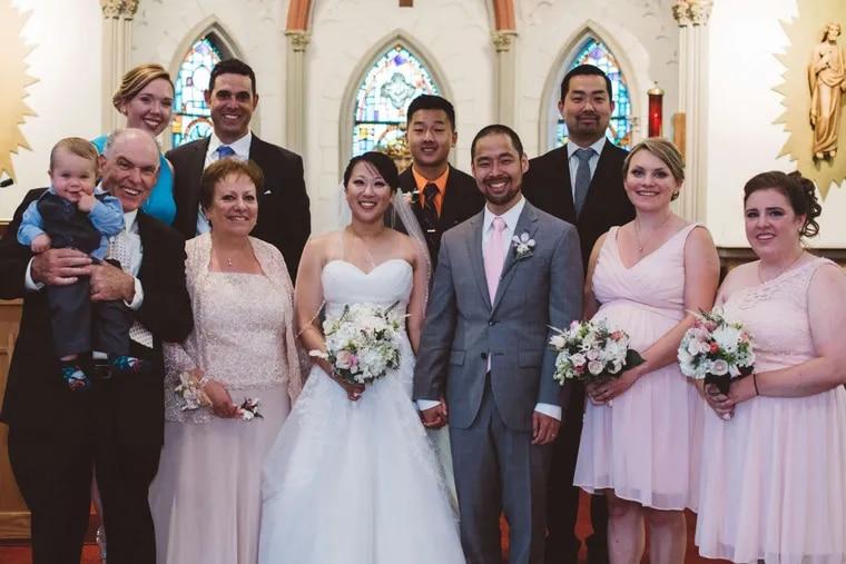 Elisabeth McPeak and Arthur Sato with their families.