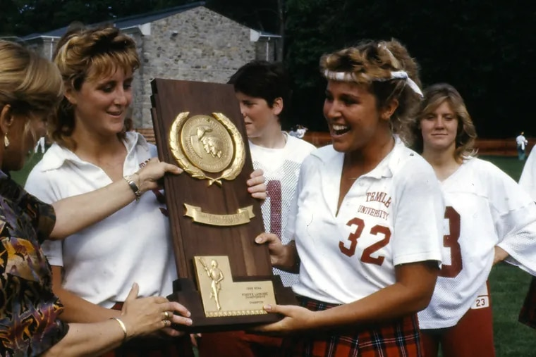 Gail Cummings-Danson (second from left) holds 1988 NCAA Championship trophy