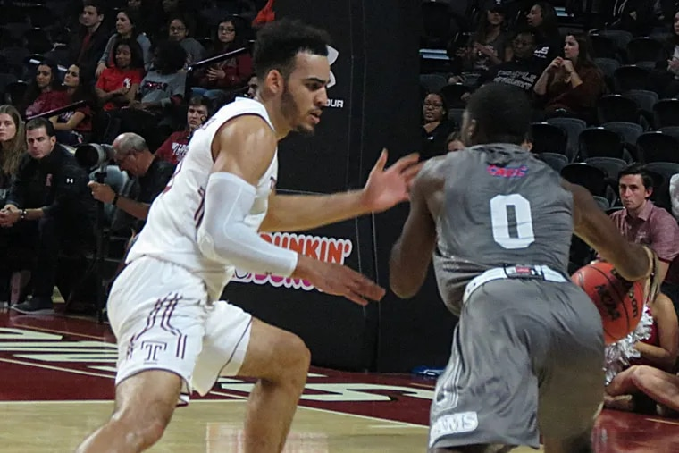 Temple's Obi Enechionyia guards Jefferson's Price Hickson during Thursday's charity exhibition at the Liacouras Center.