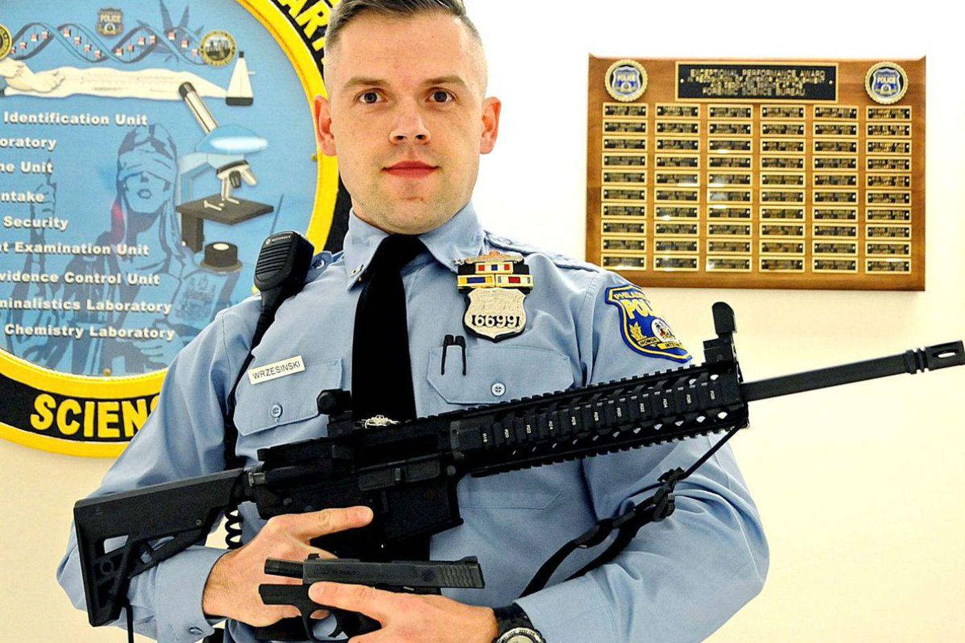How the 12-year-old Northeast Philly boy ended up toting an assault-style rifle