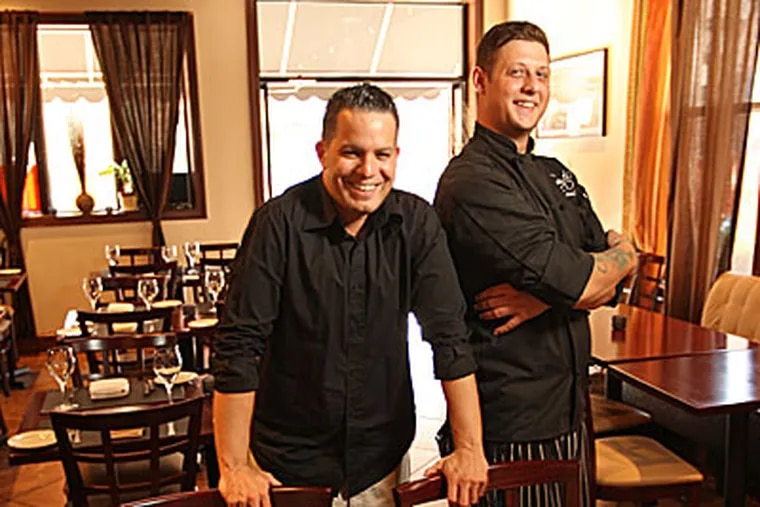 Co-owner Hector Torres (left) and chef Nicholas Cassidy in their 42-seat dining room, in the former La Creole space. (Michael Bryant / Staff Photographer)