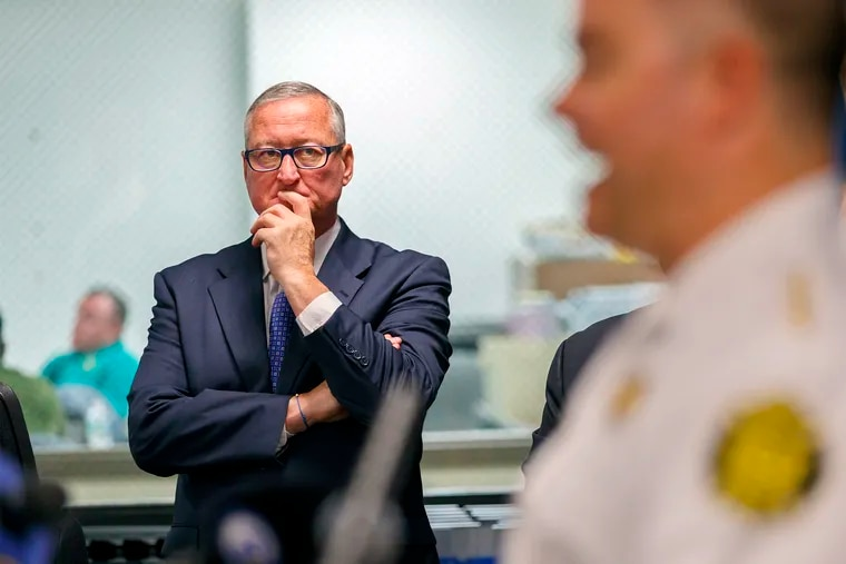 Philadelphia Mayor Jim Kenney, left, listens  to Philadelphia Fire Commissioner Adam Thiel, right, as he updates the media on Tuesday about conditions at the PES Refinery after the fire last Friday. The next day, Kenney announced the refinery would close.
