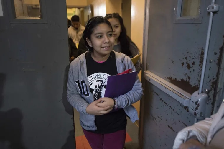 Mexican immigrants, Yoselin Artillero Apolonio, 11 and her sister, Keyri,13, make their way out of the Church of the Advocate to attend school in Philadelphia, Monday, January 29, 2018. The girls family is living in sanctuary at the Church of the Advocate in North Philadelphia.