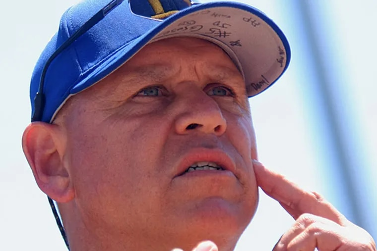 Buena coach Harry Grose signals to his pitcher during a game last spring. (Lou Rabito/Staff)