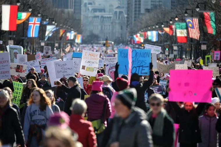 Marchers make their way up the Ben Franklin Parkway during the 2019 Women's March on Philadelphia.