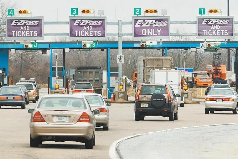 Automobiles drive into the Fort Washington Interchange of the Pennsylvania Turnpike Tuesday, Jan. 13, 2004.