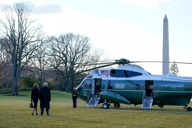 Former President Donald Trump, left, and first lady Melania Trump walking to Marine One as they left the White House for the final time.