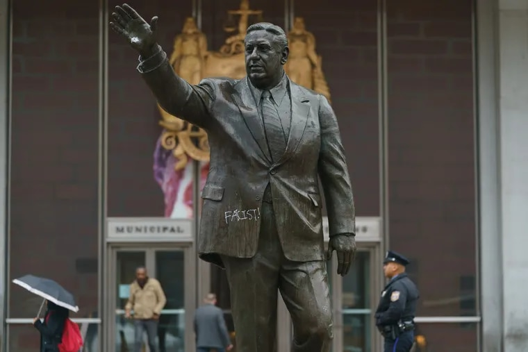 Graffiti on the Frank Rizzo statue in front of the Municipal Services Building in Philadelphia, December 09, 2019.