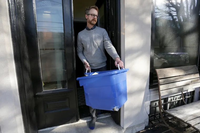 Nathaniel Popkin with his recycling at his home in Philadelphia on February 26, 2019.