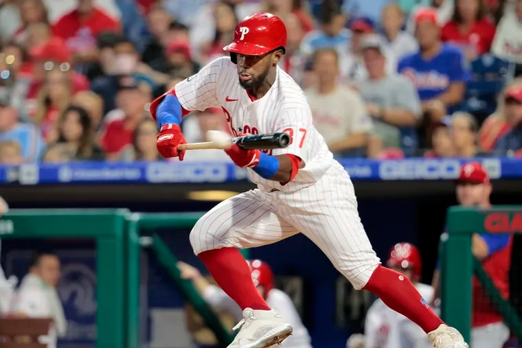 Phils Odubel Herrera lays down a perfect bunt double that knocked in two runs in the fourth inning against the Colorado Rockies on Sept. 11, 2021.