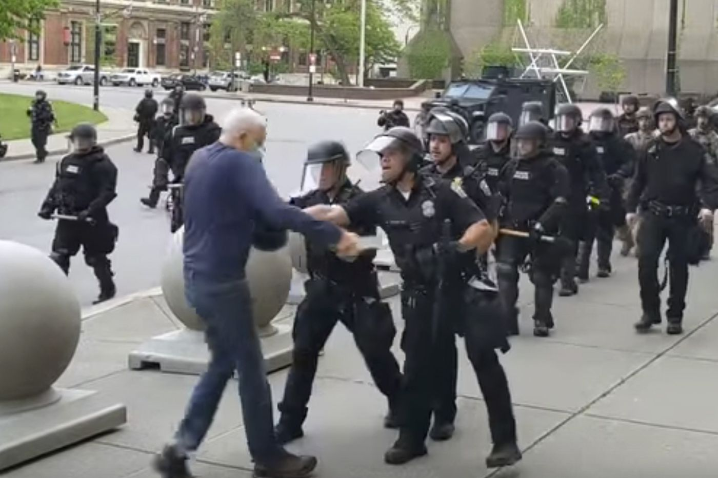 Two Buffalo officers suspended after shoving 75-year-old protester to the ground, where he lay bleeding, motionless