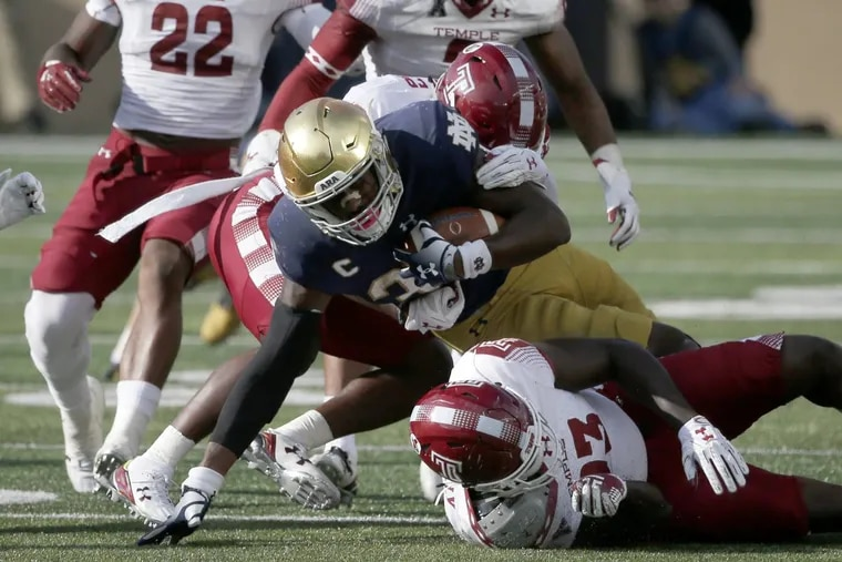 Notre Dame running back Tony Jones Jr. (34) carries the ball over Temple linebacker Shaun Bradley during the second half Sept. 2 in South Bend, Ind.