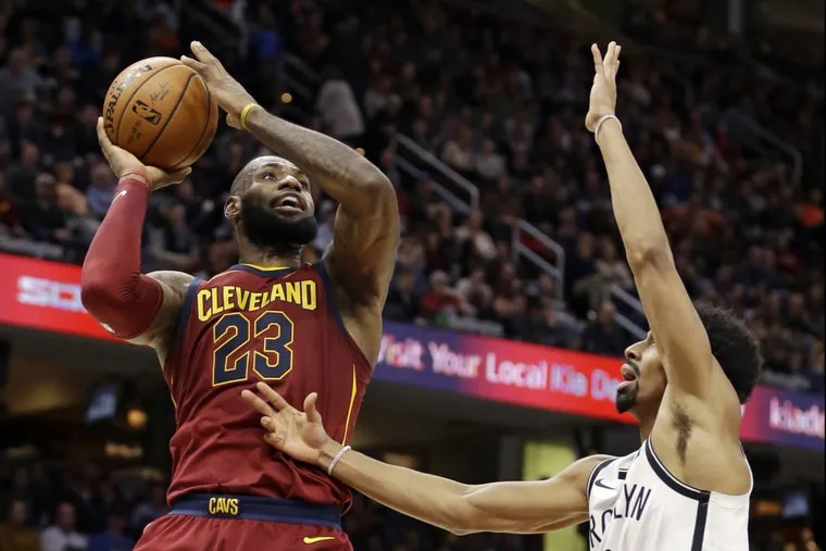 Cleveland Cavaliers' LeBron James (23) drives to the basket against Brooklyn Nets' Spencer Dinwiddie (8) during the second half of an NBA basketball game, Wednesday, Nov. 22, 2017, in Cleveland. The Cavaliers won 119-109. (AP Photo/Tony Dejak)