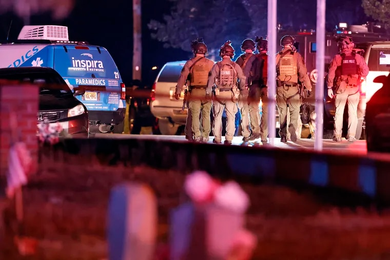 Members of the N.J. State Police F.A.S.T. Team at the scene of a multiple shooting at 1029 E. Commerce St. in Fairfield Twp., Cumberland County, N.J. shortly before midnight on May 22, 2021. Unconfirmed reports from the Breaking News Network were that 12 people had been shot with 4 of them being DOA and an active shooter was still on the scene.