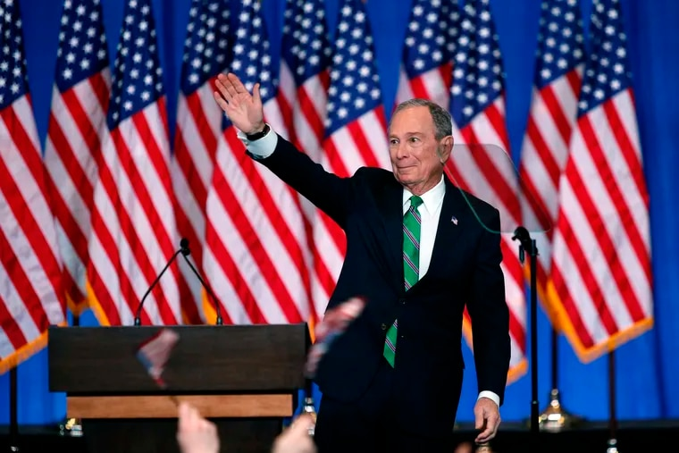 Former Democratic presidential candidate Mike Bloomberg waves to supporters as he announces the suspension of his campaign and his endorsement of Vice President Joe Biden on March 4.