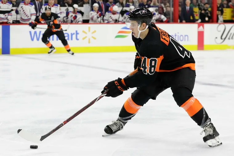 Flyers center Morgan Frost, skating with the puck against the New York Rangers last Monday, was demoted to the AHL's Phantoms on Sunday.