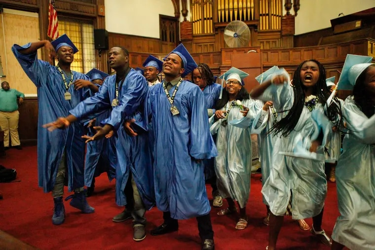 Students from the Mitchell K-8 School eighth grade class of 2018 sing as part of their graduation Friday morning. All but four completed the no-fighting challenge that earned them $100.