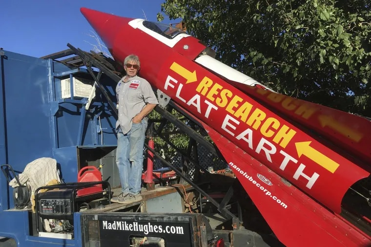 In this Wednesday, Nov. 15, 2017, photograph, daredevil/limousine driver Mad Mike Hughes is shown with with his steam=powered rocket constructed out of salvage parts on a five-acre property that he leases in Apple Valley, Cal.