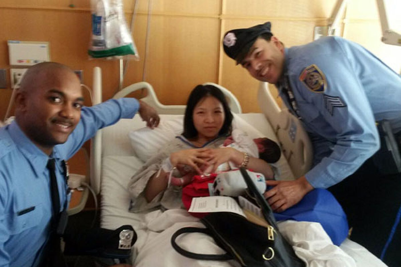 Officers who helped baby into the world come bearing gifts