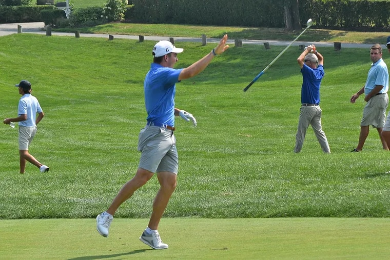 John Peters, an incoming freshman at Duke, joyfully flips his club after holing out a 193-yard approach shot at the 18th hole at Merion Golf Club for an eagle 2 and the victory in the Pennsylvania Amateur.