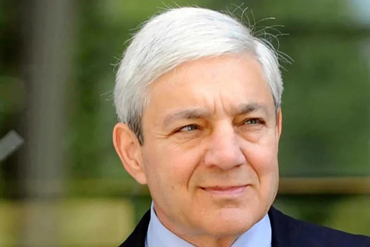 Former Penn State president Graham Spanier exits the Dauphin County Courthouse on July 29, 2013, in Harrisburg.