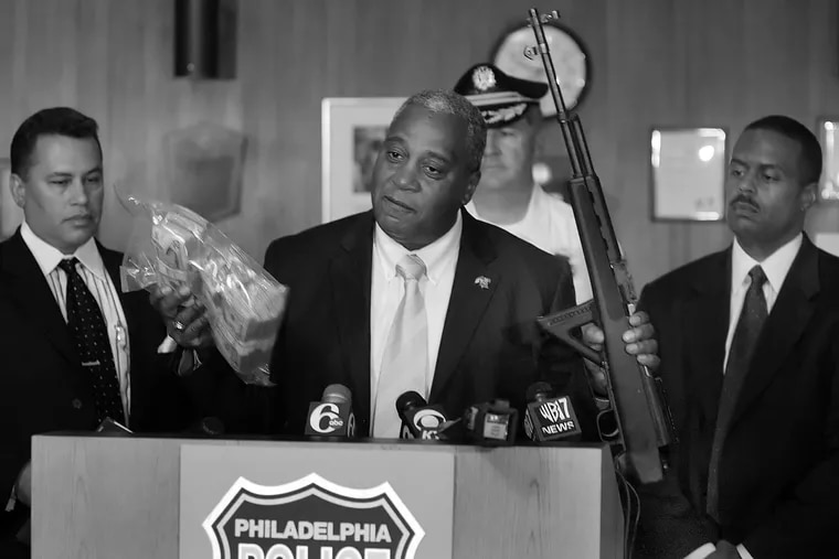 Philadelphia Police's Narcotic Strike Force with Commissioner Sylvester Johnson in 2005 showing off $ 75,000 in cash and a assult weapon.