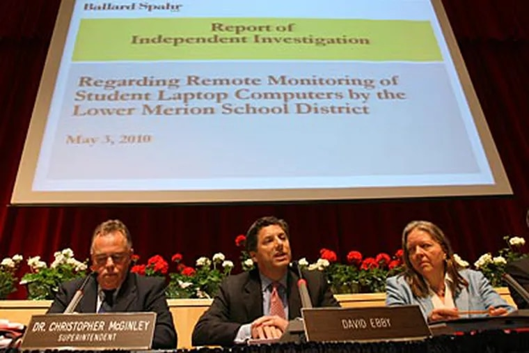 David Ebby (center) of the Lower Merion School Board addresses the crowd waiting to hear the report's findings. Superintendent Dr. Charles McGinley is seated at left. ( Charles Fox / Staff Photographer )