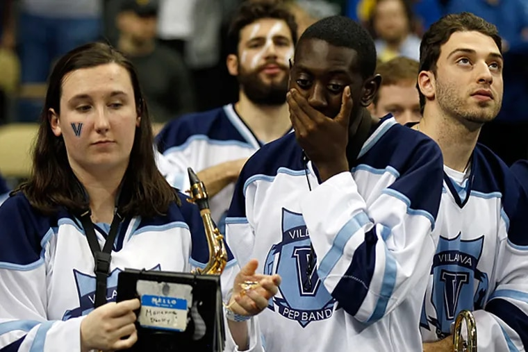 Villanova band members stand dejected after the basketball team lost to North Carolina State. (Yong Kim/Staff Photographer)