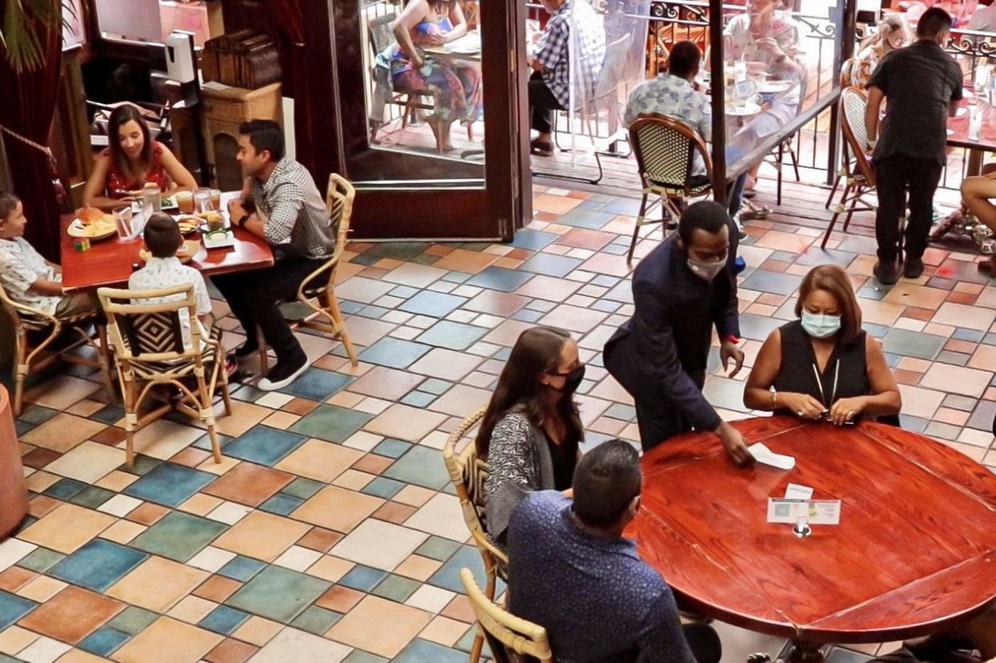 Indoor dining is back at Philly-area restaurants, and some customers seem to be eating it up