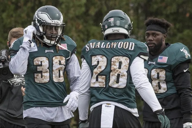 Newly acquired Eagles running back Jay Ajayi (left) walks past running backs Wendell Smallwood and Kenjon Barner during his first practice with the Eagles at the NovaCare Complex November 1, 2017. Ajayi was acquired in a trade with the Miami Dolphins. CLEM MURRAY / Staff Photographer