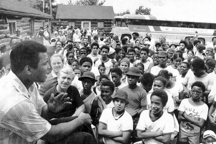 Muhammad Ali talks to a group of visitors at his training camp in Deer Lake, Pa.