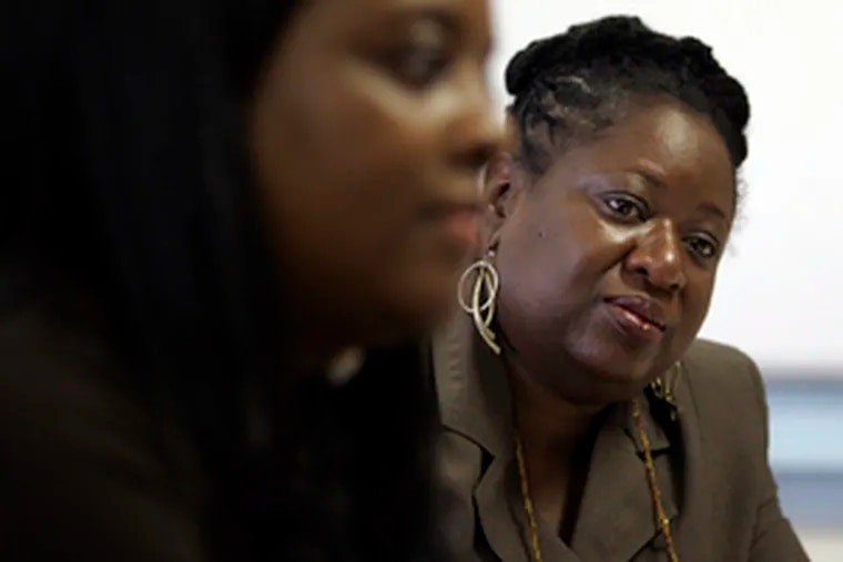 """Lori Blue (left) shares the credit with Willette Jones, an award-winning district principal at Fitler Academic Plus, and other staffers. """"It's not like me and Rachael pulled our capes out of the drawer and did this,"""" Blue said."""
