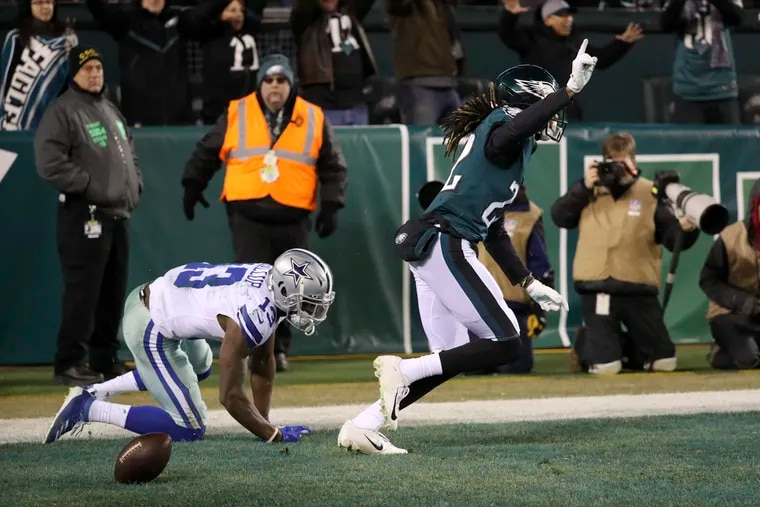 Eagles cornerback Sidney Jones celebrates after his game-sealing block of a pass intended for Dallas Cowboys wide receiver Michael Gallup in the final seconds of the fourth quarter.