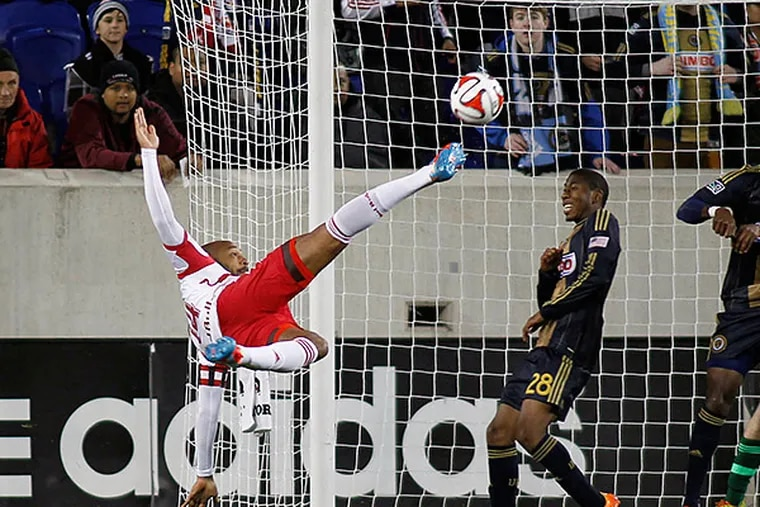 New York Red Bulls forward Thierry Henry tried a scissor-kick shot during the first half. (Andy Marlin/USA Today Sports)