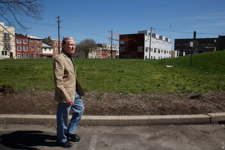 """Gregory Antczak at the site of the old Anzon factory, near a mound known as """"Mount Wawa"""" where the state found alarming levels of lead."""