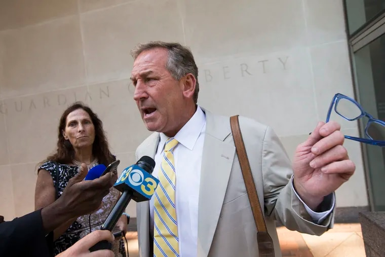 A file photo shows attorney Michael van der Veen speaks to reporters outside federal court in Philadelphia on Aug. 1, 2019, after his client Justin Hiemstra, 22, an ex-Haverford College student, pleaded guilty to trying to hack into IRS computers to get Donald Trump's tax returns. Hiemstra was to be sentenced Monday.