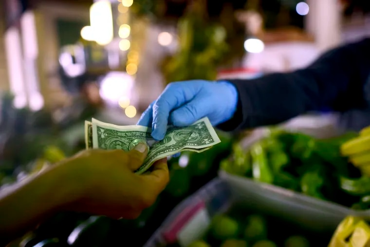 Philadelphia has the lowest minimum wage of any city in the U.S. when adjusted for the cost of living, according to a Pew study released May 20, 2020. That's partly due to a 2006 Pa. state law that forbids raising the $7.25 minimum. (AP Photo/Carlos Giusti)