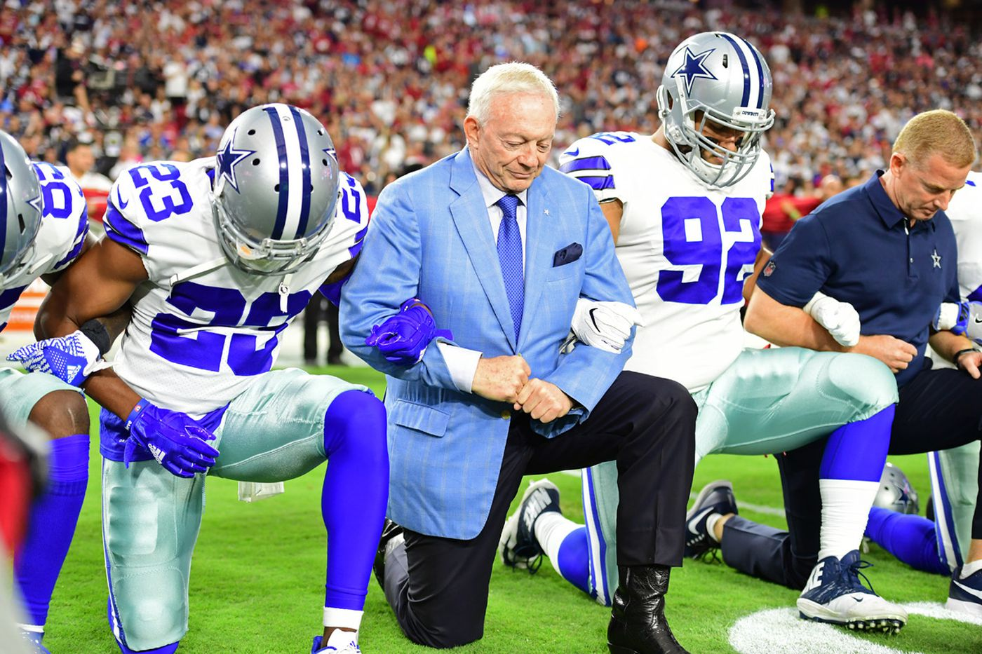 4dbc5006971 Cowboys owner Jerry Jones kneels alongside his players prior to the playing  of the national anthem