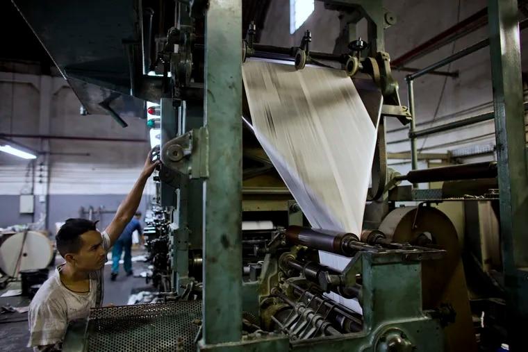 File Photo: A newspaper printing press.