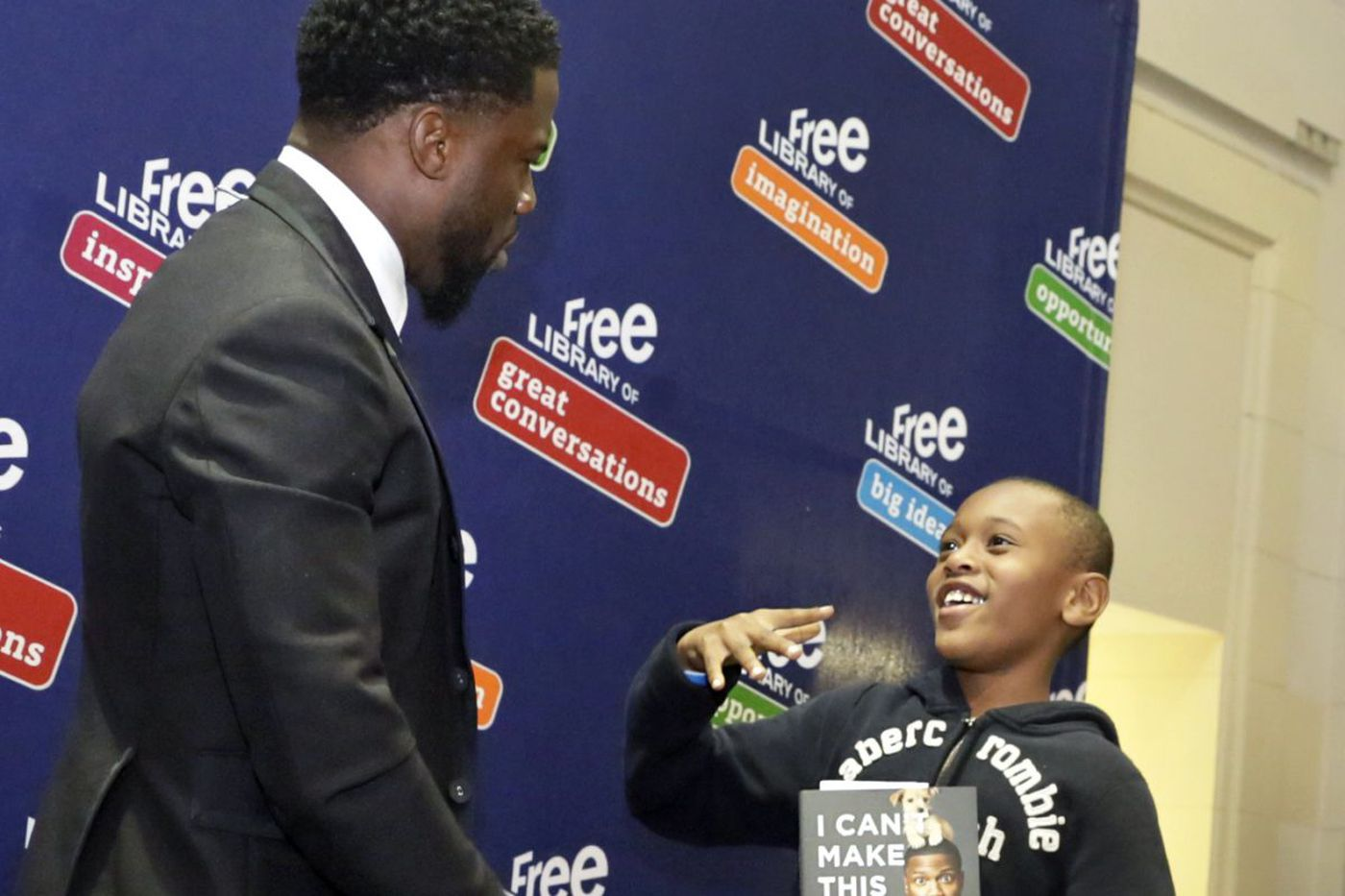 Promoting books Kevin Hart style: The Philly-born superstar posed for pics with fans at the Free Library