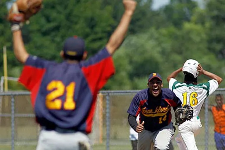 Frankford's Kevin Montero and Brandon Gonzalez celebrate the final out in the Public League championship. (Yong Kim/Staff Photographer)