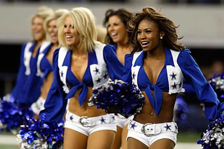 The Cowboys Cheerleaders perform before last year's wild-card playoff game against the Eagles. (AP file photo/Sharon Ellman)