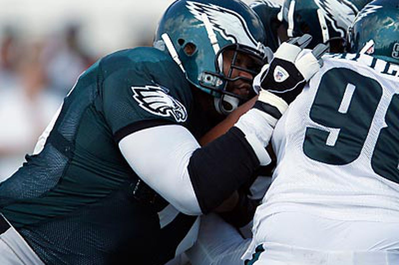 Eagles deal Stacy Andrews to Seattle, obtain DE Barnes from Baltimore