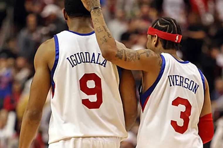 Allen Iverson consoles teammate Andre Iguodala. After the game Iverson was complaining that he was sore. (Steven M. Falk / Staff Photographer)
