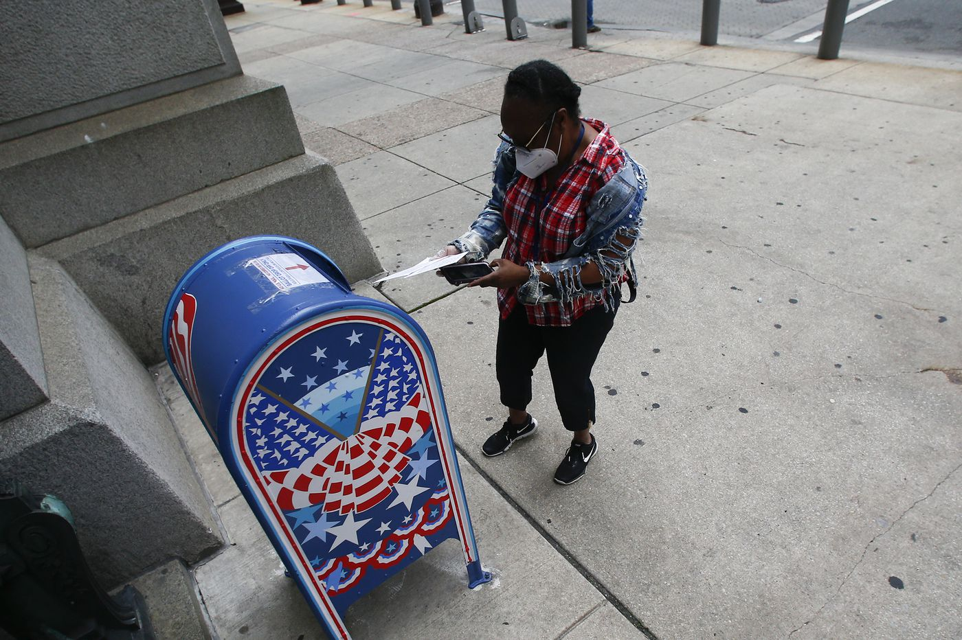 USPS says Pennsylvania mail ballots may not be delivered on time, and state warns of 'overwhelming' risk to voters